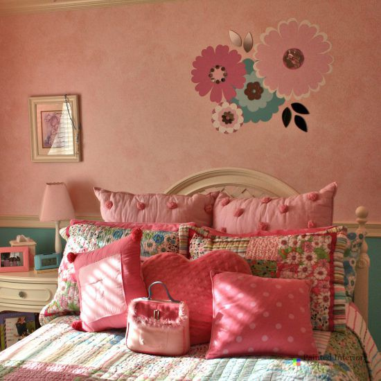 hand painted flowers with mirror accents over pink glazed walls