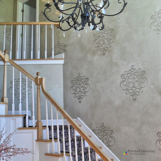 stencil design over glazed wall